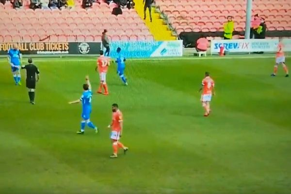A Blackpool steward is hit on his head by the ball during a game against Peterborough United