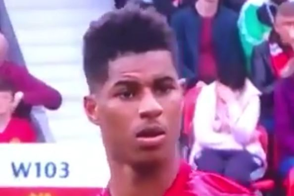 A Man Utd fan puts her head in her hands when she realises Marcus Rashford will be taking a free kick at Old Trafford against Chelsea