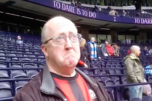 A Huddersfield supporter copies the emotional, crying Spurs fan at the sight of Tottenham's new stadium