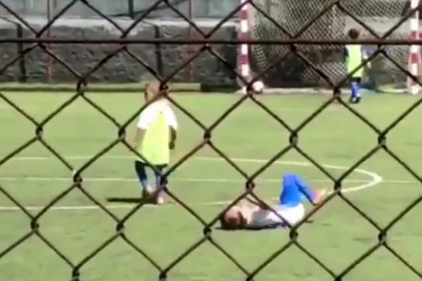 Goal scorer is kicked while celebrating goal in children's game