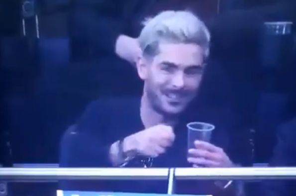 Zac Efron talks enthusiastically about the Bottoms Up beer-pouring technology at Tottenham Hotspur's new stadium while attending their game against Brighton