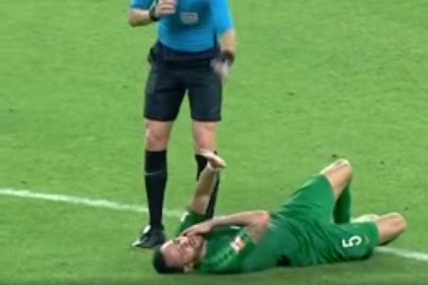 Beijing Guoan's Renato Augusto runs into the referee during a match