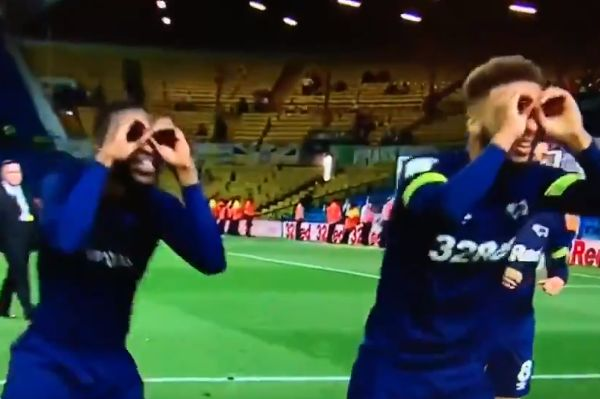 Derby County players mock Leeds United with imaginary binoculars referring to Spygate