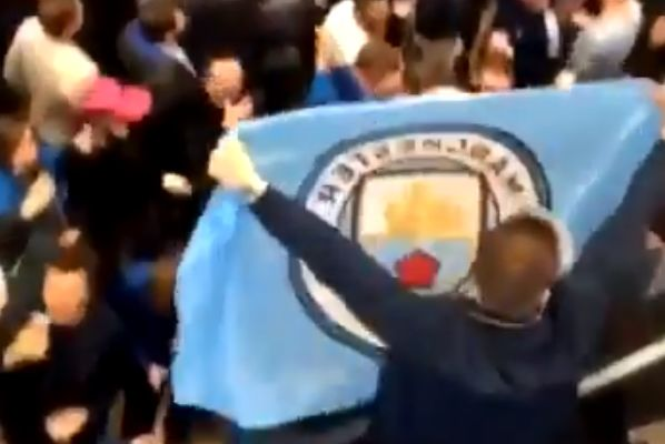 "Everton fans at Tottenham Hotspur wave a Manchester City flag and sing their club anthem ""Blue Moon"""