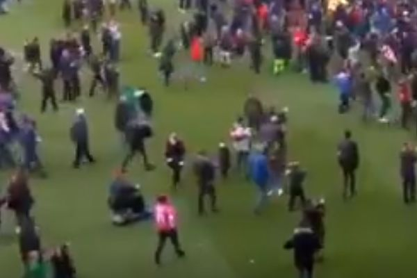 Leyton Orient fan on a mobility scooter joins pitch invasion at Brisbane Road