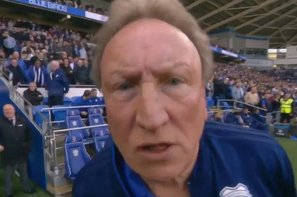Cardiff City manager Neil Warnock stares at a camera and walks towards it before the 2-3 defeat to Crystal Palace