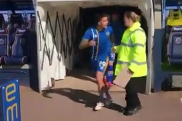 Shrewsbury Town's Oliver Norburn almost runs into steward as he comes out of the tunnel before 0-0 with Walsall