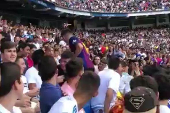 Fan in Barcelona shirt at Eden Hazard presentation after he signs for Real Madrid