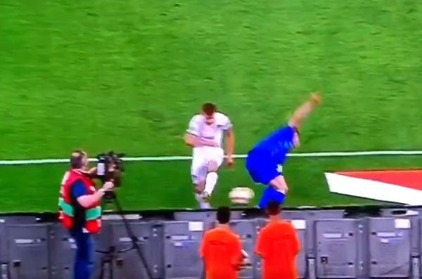 Italy midfielder Nicolò Barella kicks the ball into a ball boy's head during the 3-0 win in Greece