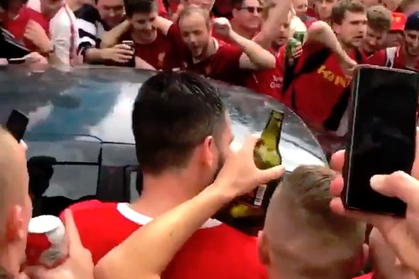 Car drives through Liverpool supporters in Concert Square in the city centre before the Champions League final