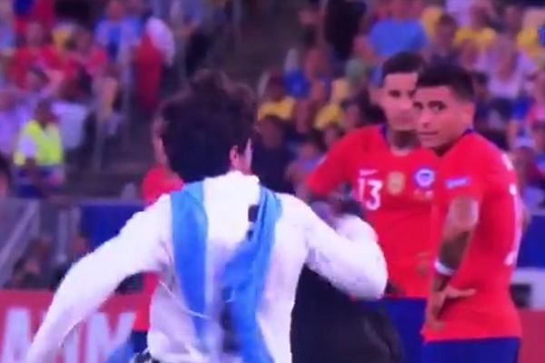 Gonzalo Jara trips pitch invader with chicken mask during Chile vs Uruguay at Copa América