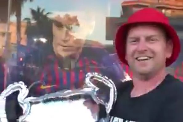 Singing Liverpool fans went to a Barcelona club shop with inflatable Champions League trophies