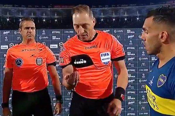 Referee catches coin he let slip during the toss before Copa de la Superliga final between Tigre and Boca Juniors