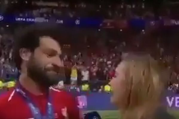 Mohamed Salah ducks from a reporter he appears to think is trying to kiss him after Liverpool won the Champions League