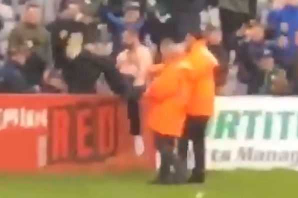 Shamrock Rovers pitch invader falls over the advertising hoardings during the 2-1 defeat at Bohemians