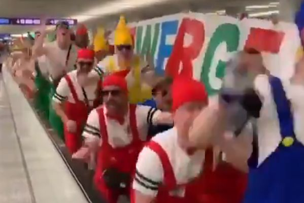 VfB 03 Hilden players and staff dress as characters from Snow White and the Seven Dwarfs and sing Yaya/Kolo chant at airport on way to Mallorca