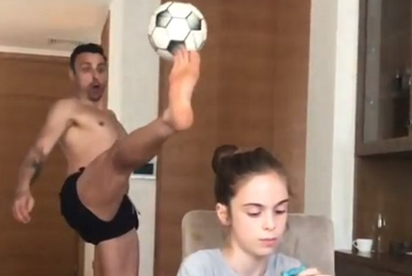 Dimitar Berbatov prevents ball from hitting his daughter while playing football in kitchen