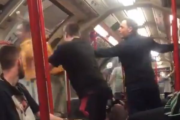 Disruptive Chelsea fan gets shoved off a train just as the doors are about to close