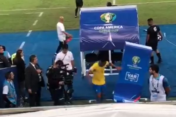 Brazil's Gabriel Jesus pushes VAR on-field review screen after getting red card in Copa América final against Peru
