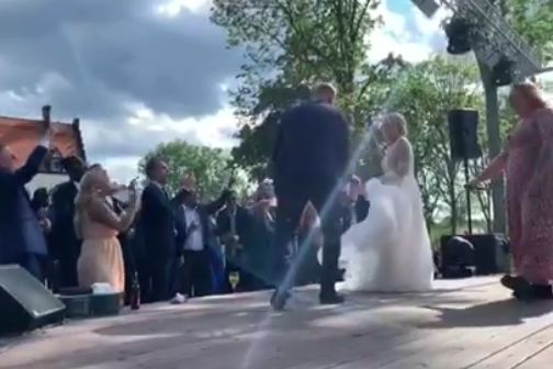 John Guidetti sings his song with guests at his wedding