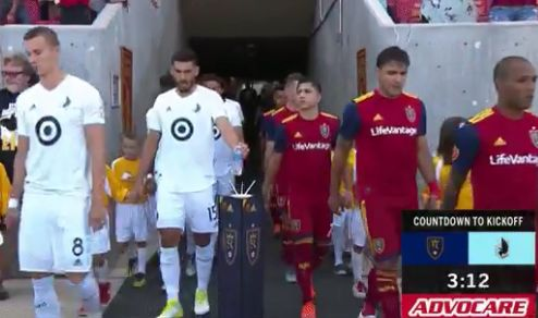Minnesota United's Michael Boxall leaves his empty bottle on the stand for the match ball before kick-off at RSL