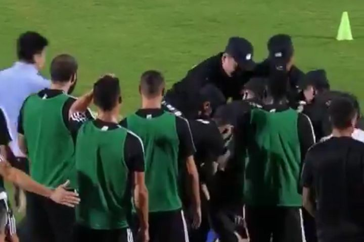 Cristiano Ronaldo jumped into security as they grabbed a pitch invader at Juventus training in China