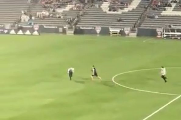 Stewards chase pitch invader in the rain during Colorado Rapids vs New England Revolution