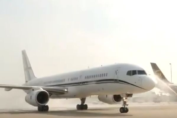 Plane carrying victorious United States given water cannon reception on runway on return from Women's World Cup in France