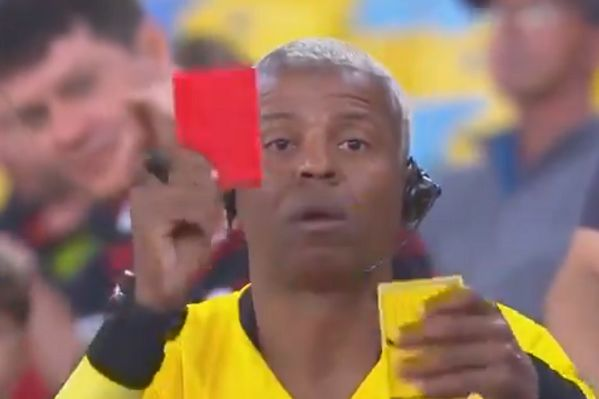 Flamengo fan dressed in full referee kit at Copa Libertadores match against Internacional