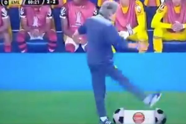 Flamengo manager Jorge Jesus kicks a digitised football TV graphic in half