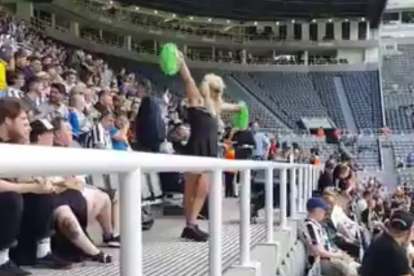 Newcastle fan in cheerleader fancy dress dances at St. James' Park ahead of a friendly with Saint-Étienne