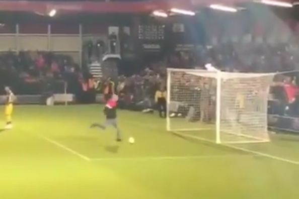 Pitch invader misses ball as he tries to shoot at Salford City vs Leeds