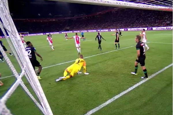 Groningen goalkeeper Sergio Padt kicks off a boot to waste time during Eredivisie match at Ajax