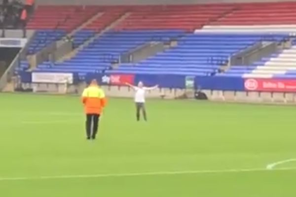 Casual pitch invader during Bolton vs Bradford in the Football League Trophy