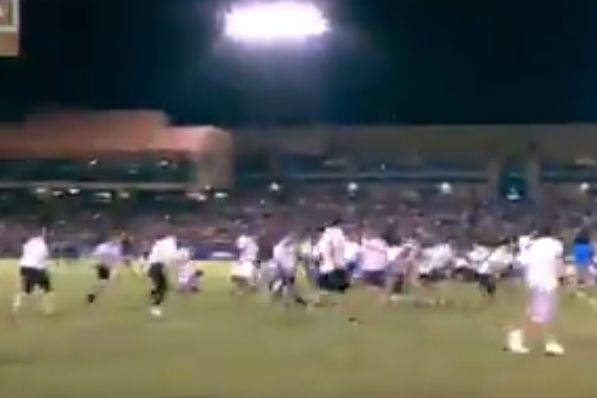 Fans scramble for cash that Las Vegas Lights dropped onto the pitch