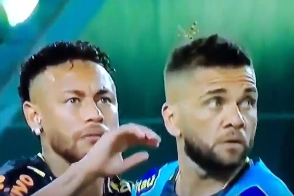 Neymar flicks a large bug off Dani Alves's head before Brazil's 2-2 friendly draw with Colombia