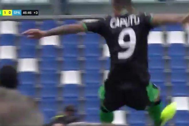 Sassuolo's Francesco Caputo trips over electronic advertising boards as he celebrates goal