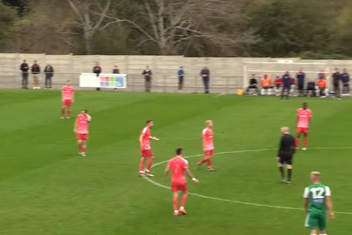Protests after Hendon score goal while goalkeeper is running back onto the pitch following treatment