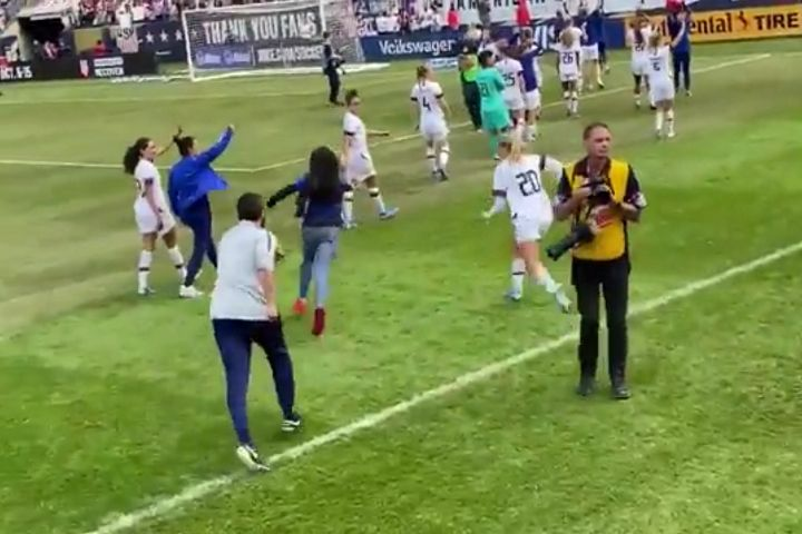 Pitch invader is chased by player after United States women's game