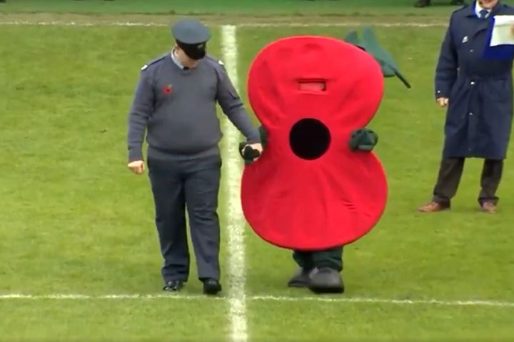 Poppy costume for Remembrance Day silence at Tranmere vs Wycombe