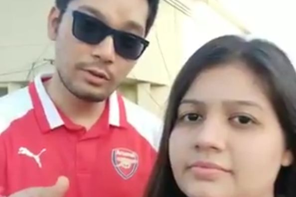 Couple of Arsenal fans in India sing a song about hating coronavirus