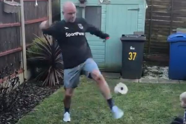 Everton fan doing toilet roll challenge in his garden accidentally kicks son in face