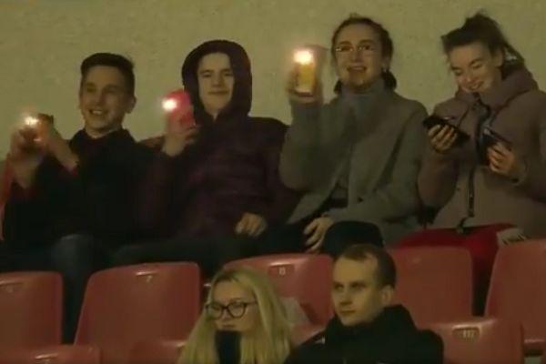 Fans wave their phone lights at the camera during Ruh Brest vs Energetik-BGU Minsk