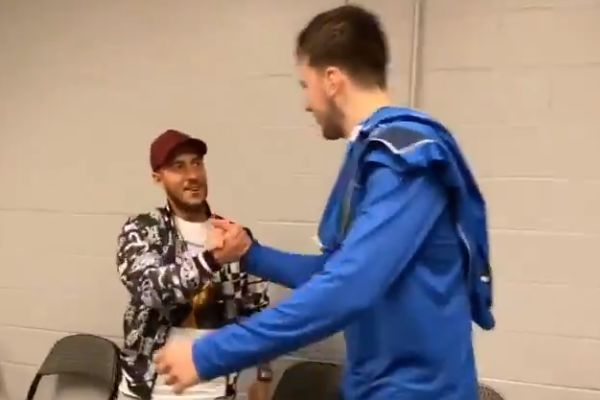 Real Madrid's Eden Hazard meets Luka Dončić of the Dallas Mavericks