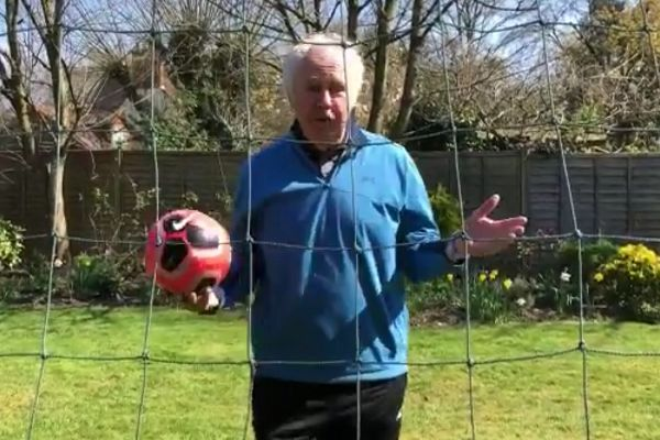 Ian Darke commentates while he plays football in the garden by himself during the coronavirus lockdown