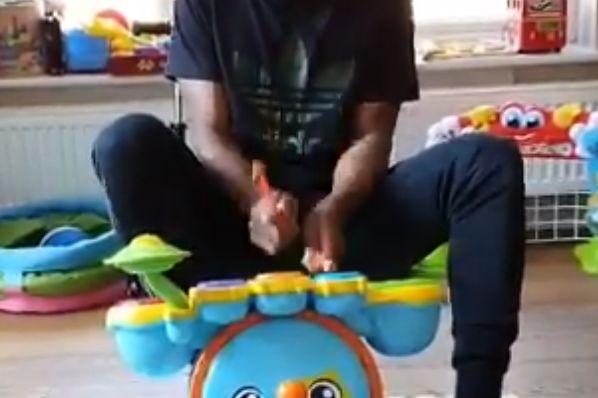 Watford defender Christian Kabasele plays children's drums