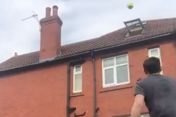 Twitter user Rory Breslin gets ball stuck behind chimney trying to kick it through roof window