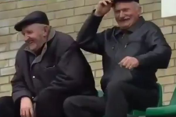 Older fans mess about in front of the camera at Neman vs Vitebsk in Belarus