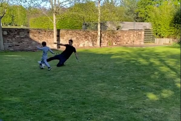 Liverpool defender Dejan Lovren slide-tackles his son while playing in the garden