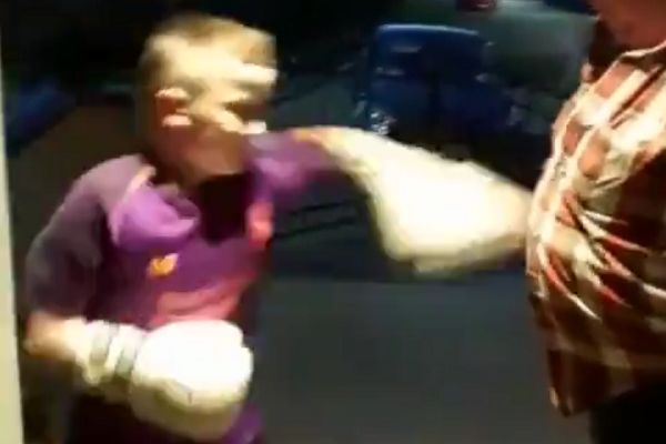 Man encourages young Liverpool fan to punch him in the stomach with boxing gloves